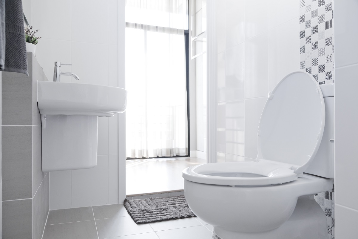 Bathroom with white toilet and sink