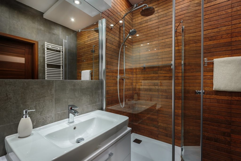 Bathroom with wooden shower walls