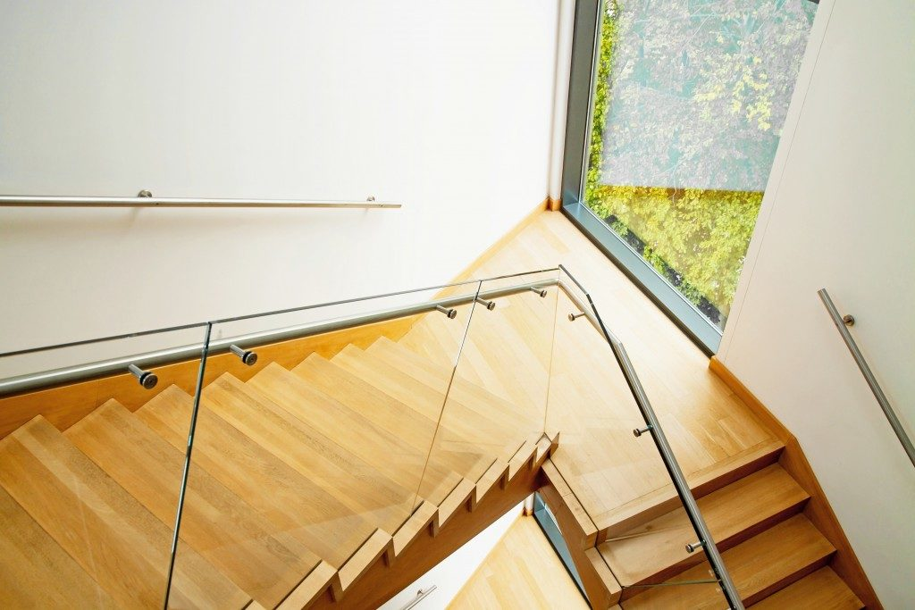 Modern interior with elegant wooden stairs