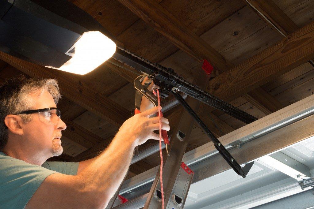 Guy fixing garage door