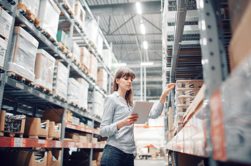 Woman at the warehouse checking inventory