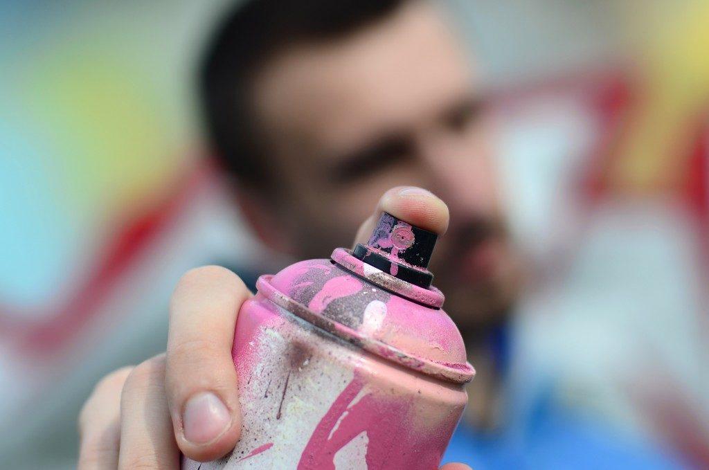 man holding a spray paint