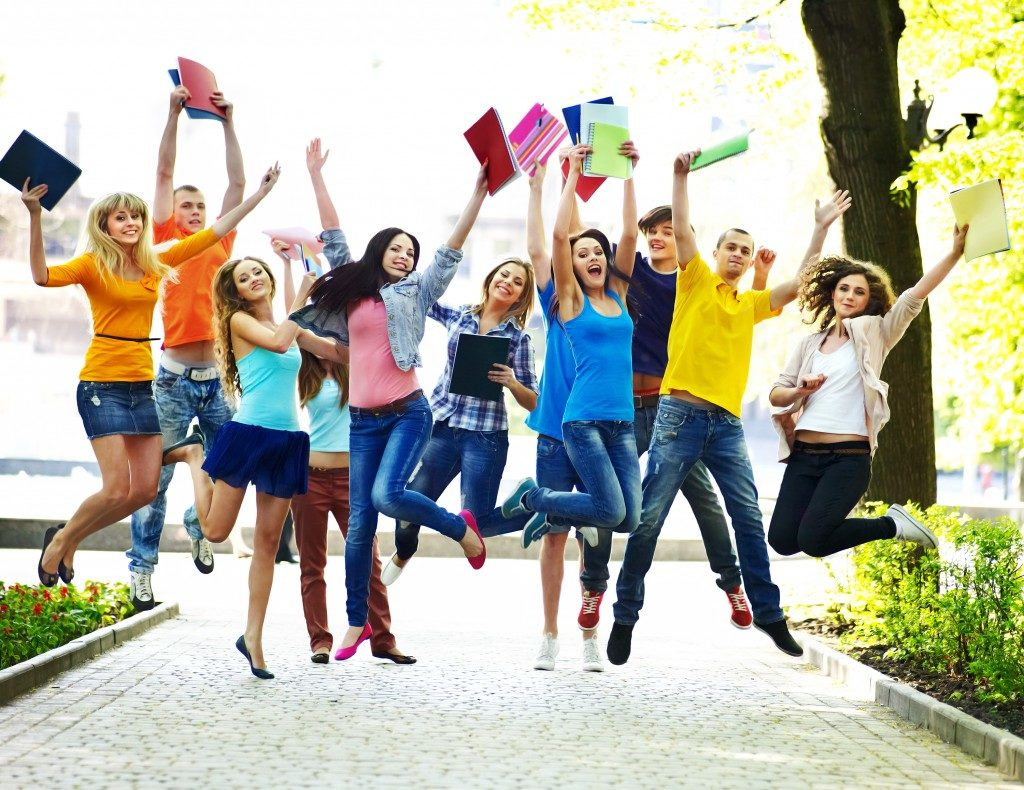 Students jumping for a photo