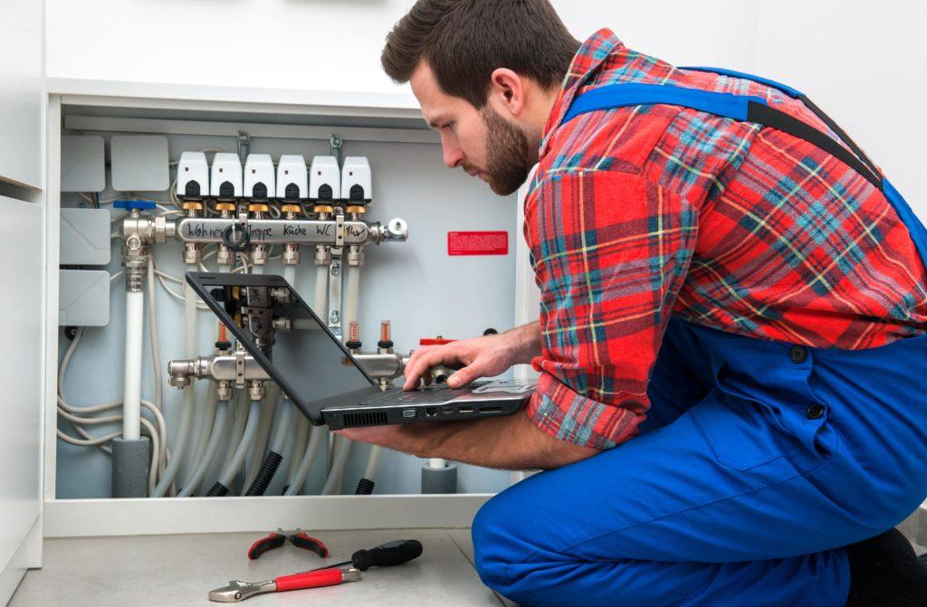 man checking heating system