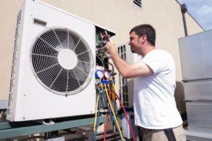 Technician checking HVAC system