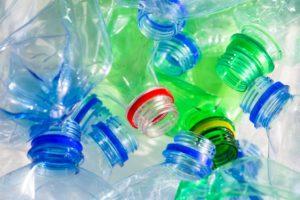 Plastic bottles with different cap colors