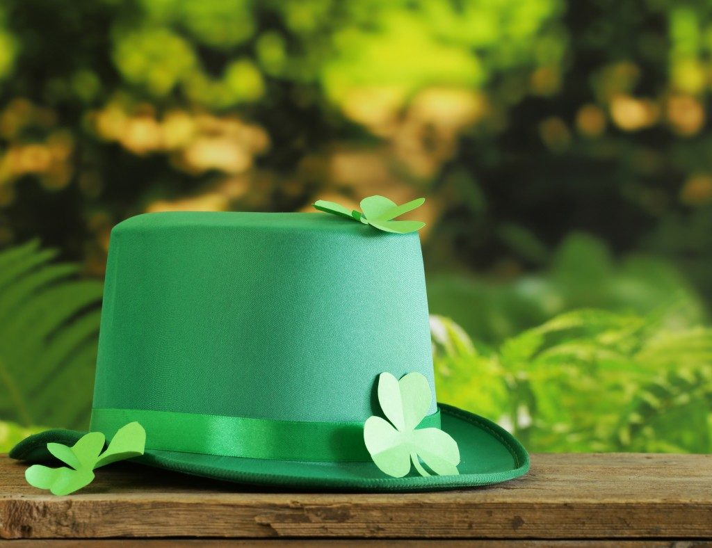 Green hat and paper clovers