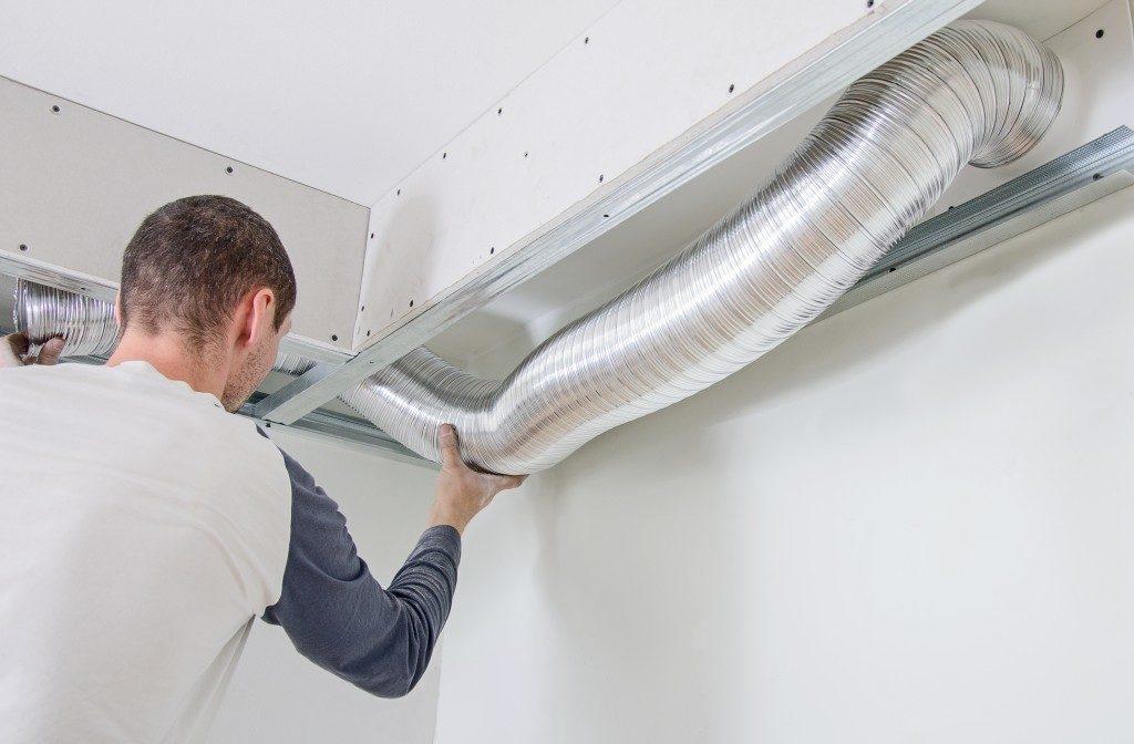 Man fixing ventilation system