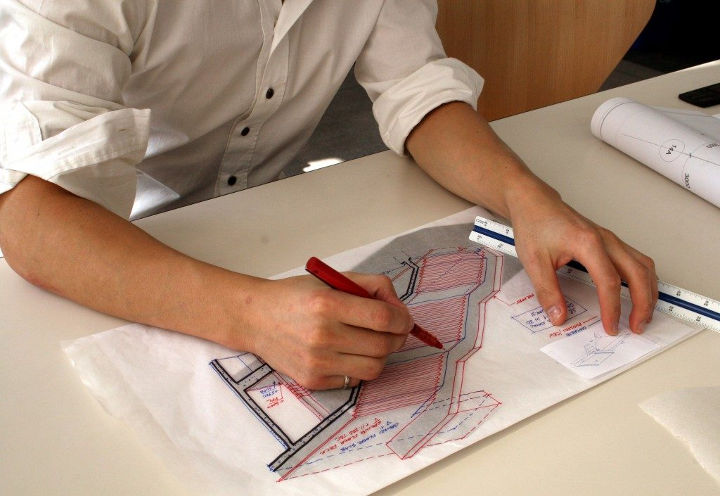 person designing a building