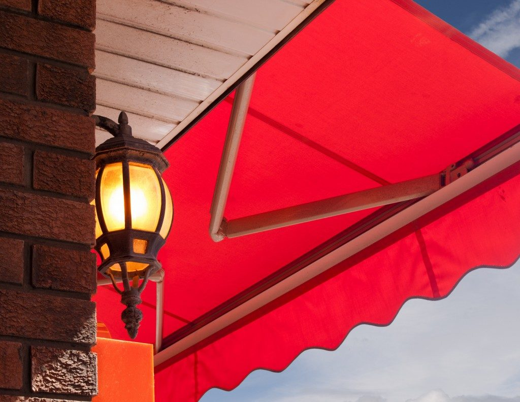Red awning above light