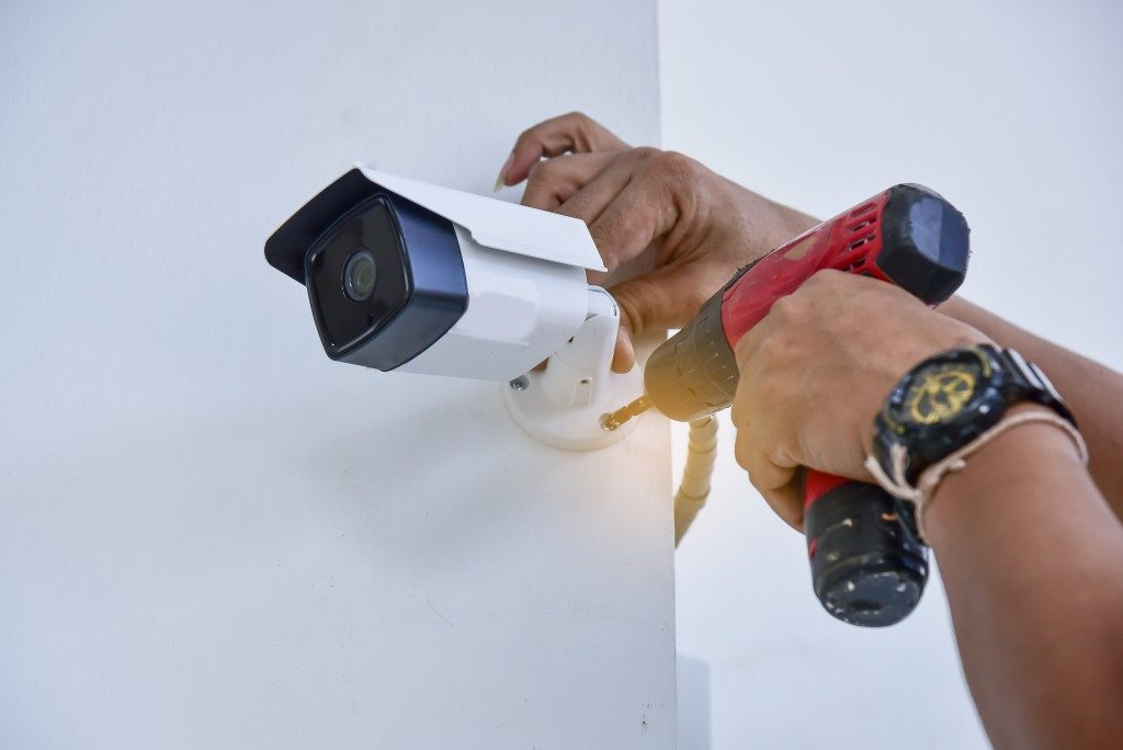 person installing security camera