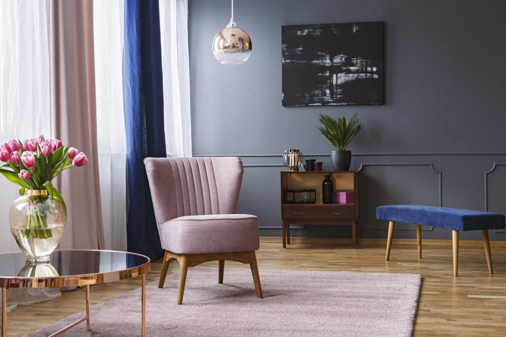 a modern style living room in pink and metal hues