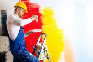 Painter working with paint