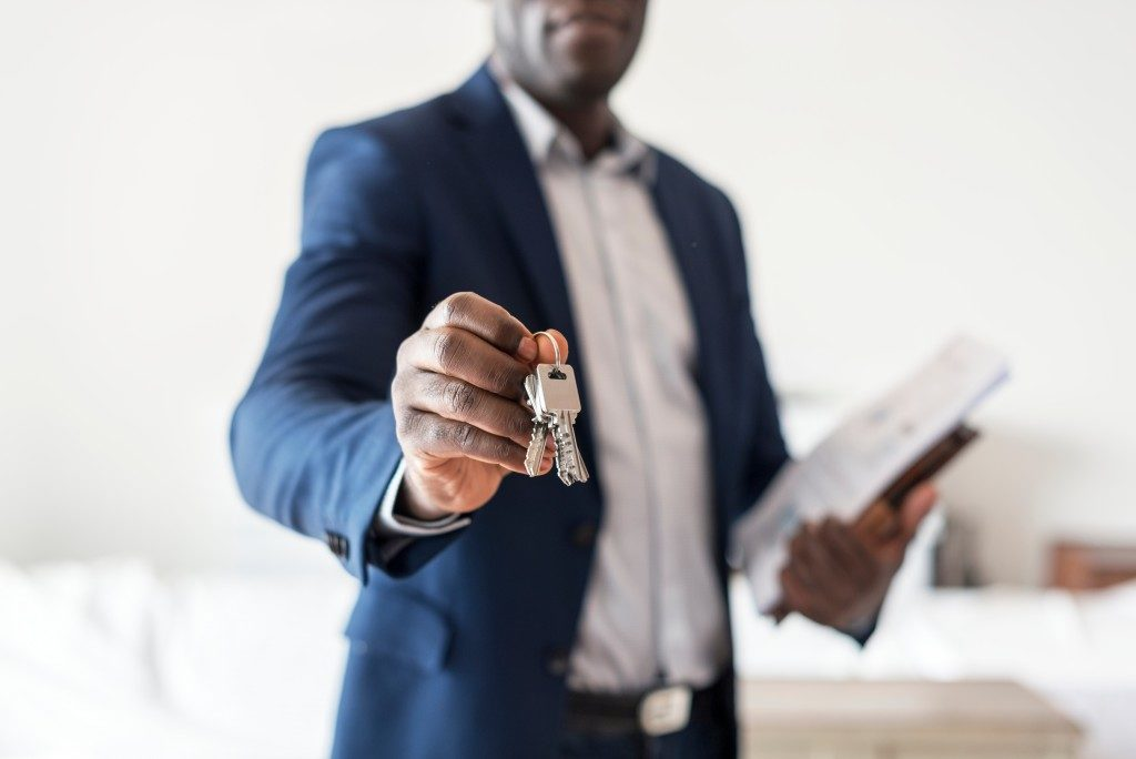 real estate agent handing the keys to property