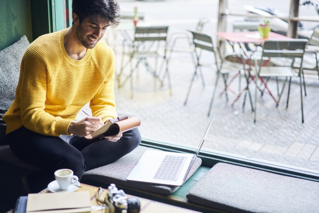 man doing his work in a cafe