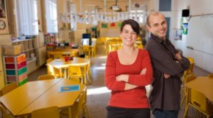Two teachers posing in the classroom