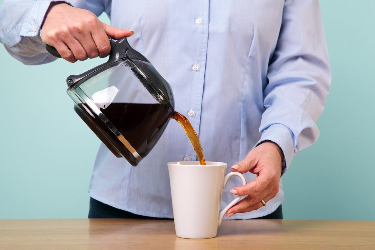 pouring coffee on a mug
