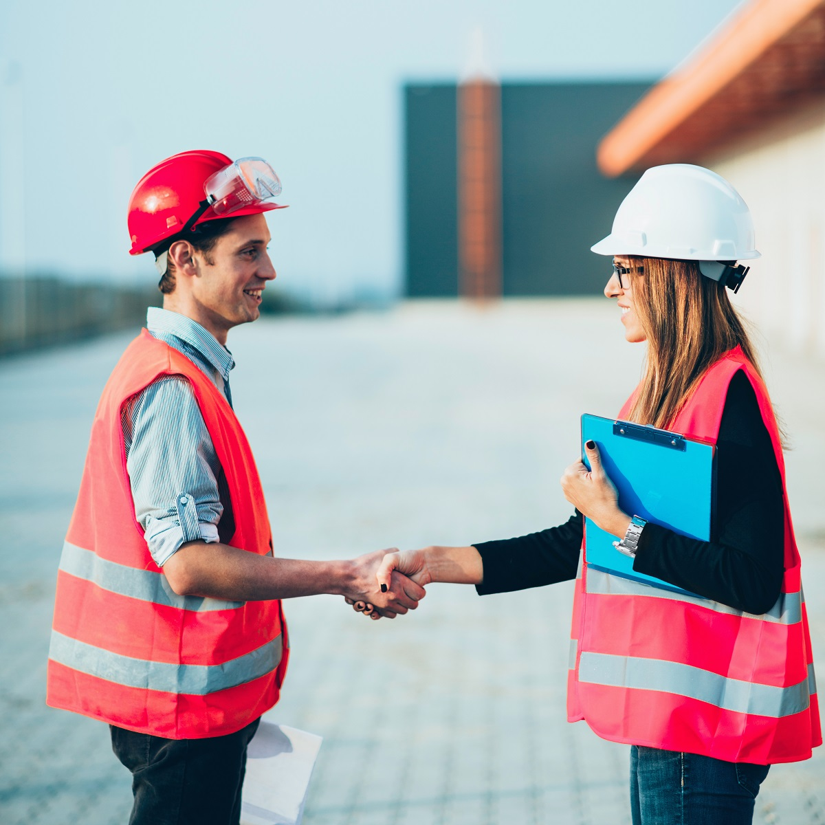 Handshaking after successful meeting on construction site