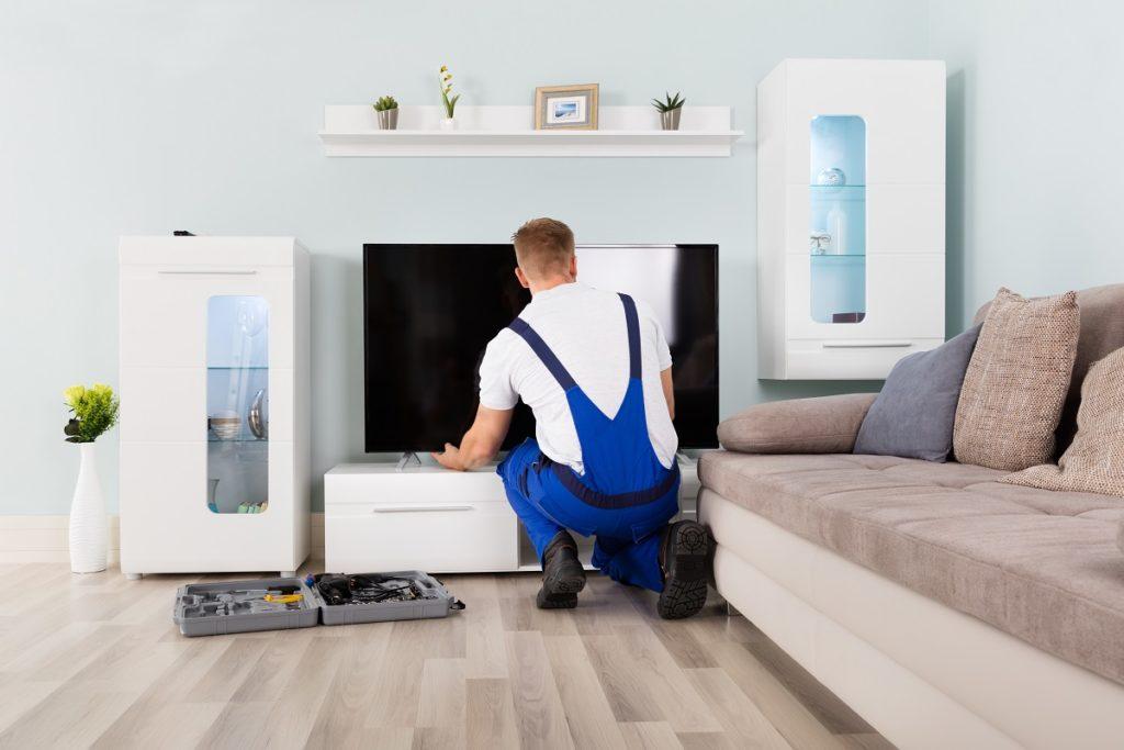 Man setting up appliances