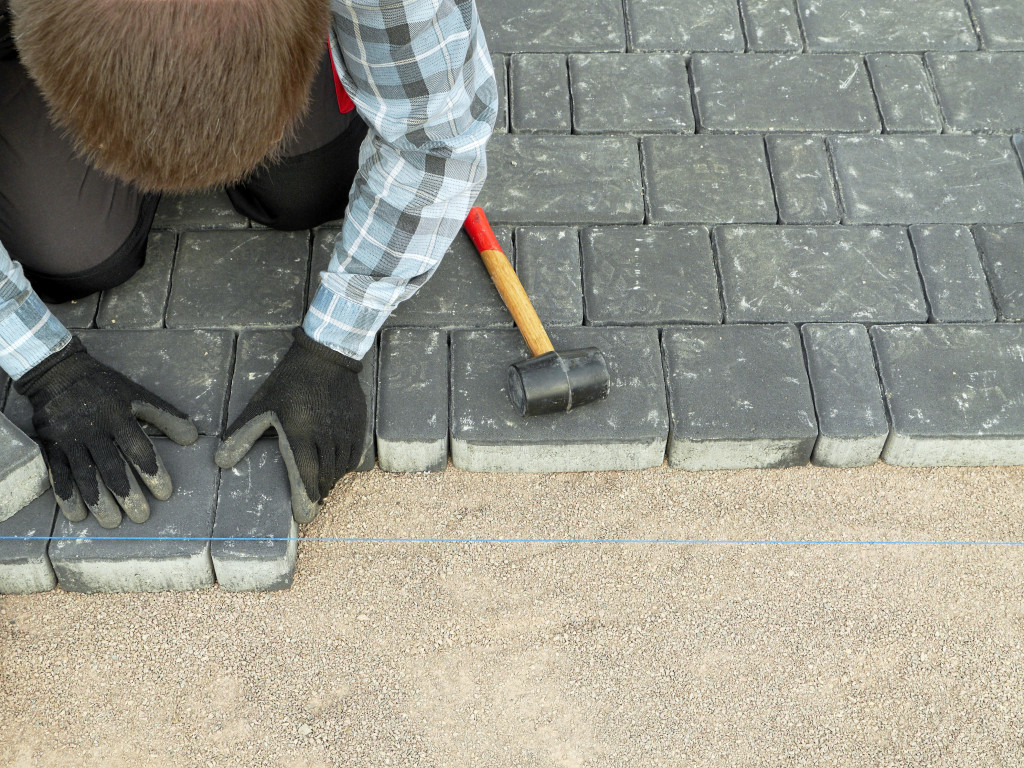 man laying out tiles