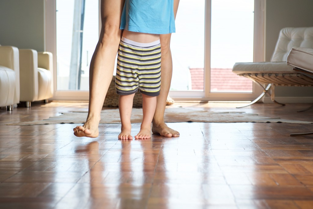 toddler and mother walking barefoot