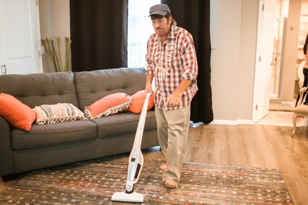 man using a vacuum