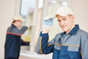 repairmen fixing window
